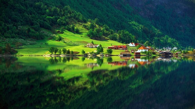 a mountain village reflected