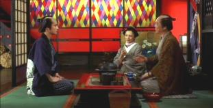9.  Seiji confers with his benefactors